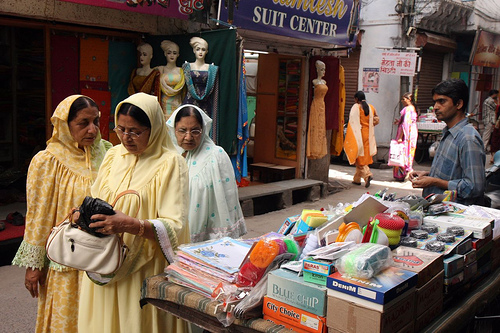 (From Flickr-Three muslim women in front of a Sari store, Udaipur India. )